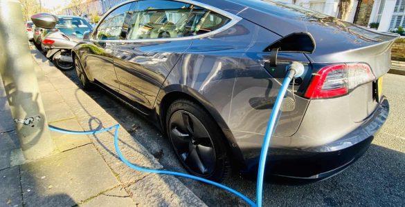 Tesla charging at a lamp post